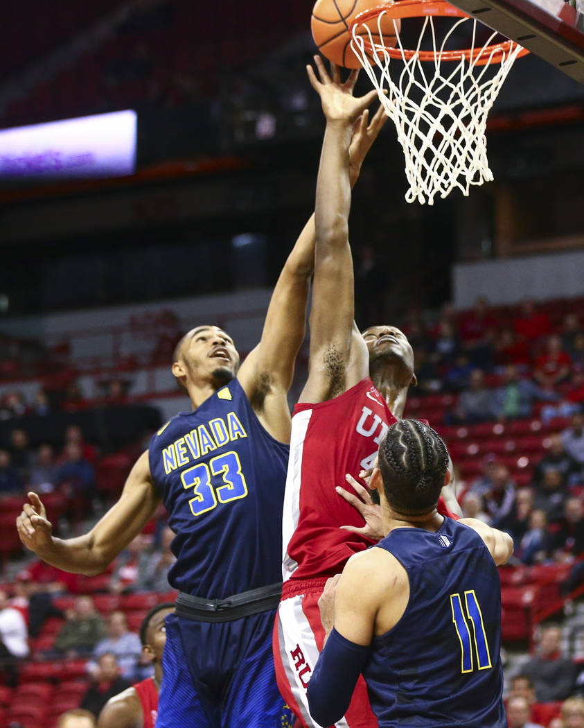 UNLV forward Brandon McCoy (44) goes to the basket as UNR guard Josh Hall (33) defends during the second half of a basketball game at the Thomas & Mack Center in Las Vegas on Wednesday, Feb. 2 ...