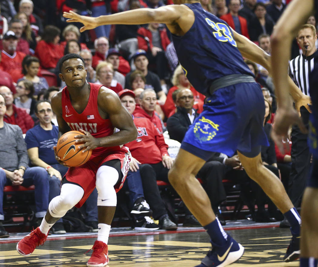 UNLV forward Shakur Juiston (10) looks to shoot against UNR guard Josh Hall (33) during the first half of a basketball game at the Thomas & Mack Center in Las Vegas on Wednesday, Feb. 28, 2018 ...