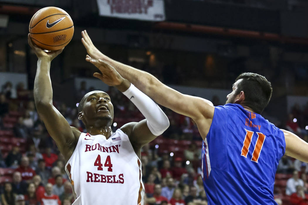 UNLV Rebels forward Brandon McCoy (44) attempt a shot over Boise State Broncos forward Zach Haney (11) during the first period of an NCAA college basketball game at the Thomas & Mack Center Sa ...