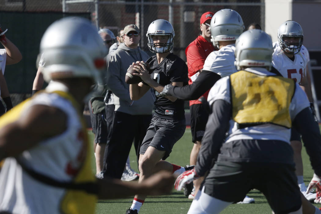 UNLV quarterback Kenyon Oblad (7) prepares to throw the ball during the first day of spring practice on Tuesday, March 6, 2018, in Las Vegas. Bizuayehu Tesfaye/Las Vegas Review-Journal @bizutesfaye