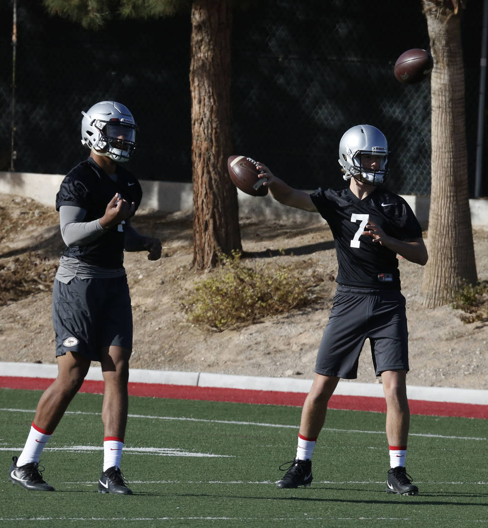UNLV quarterbacks Kenyon Oblad (7) and Armani Rogers (1) during the first day of spring practice on Tuesday, March 6, 2018, in Las Vegas. Bizuayehu Tesfaye/Las Vegas Review-Journal @bizutesfaye