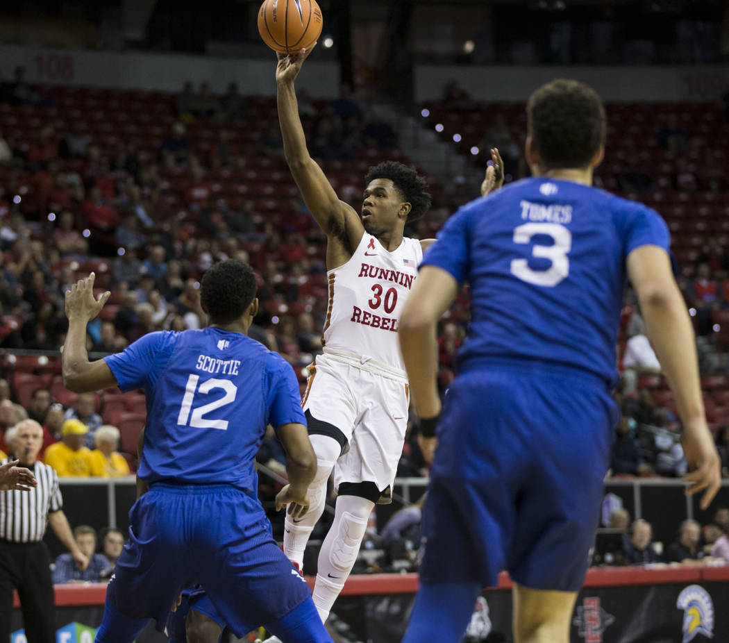 UNLV Rebels guard Jovan Mooring (30) takes a shot at the basket as Air Force Falcons forward Lavelle Scottie (12) looks on in the first half of the Mountain West Conference men's basketball t ...