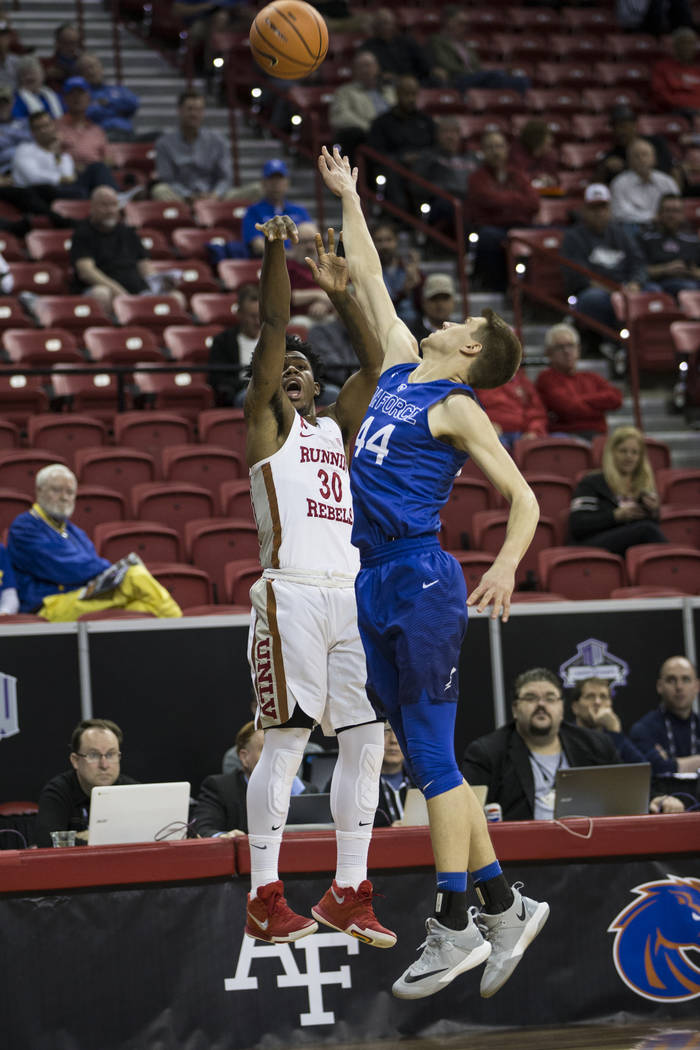 UNLV Rebels guard Jovan Mooring (30) shoots the ball against Air Force Falcons guard Keaton Van Soelen (44) in the first half of the Mountain West Conference men's basketball tournament in Henders ...
