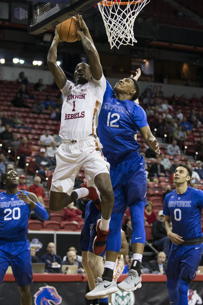 UNLV Rebels guard Kris Clyburn (1) goes up for a shot against presser from Air Force Falcons forward Lavelle Scottie (12) in the first half of the Mountain West Conference men's basketball tournam ...