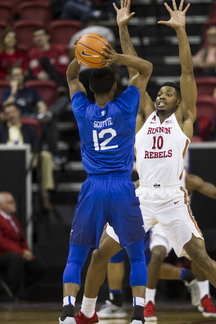 UNLV Rebels forward Shakur Juiston (10) guards Air Force Falcons forward Lavelle Scottie (12) in the second half of the Mountain West Conference men's basketball tournament game at the Thomas &amp ...