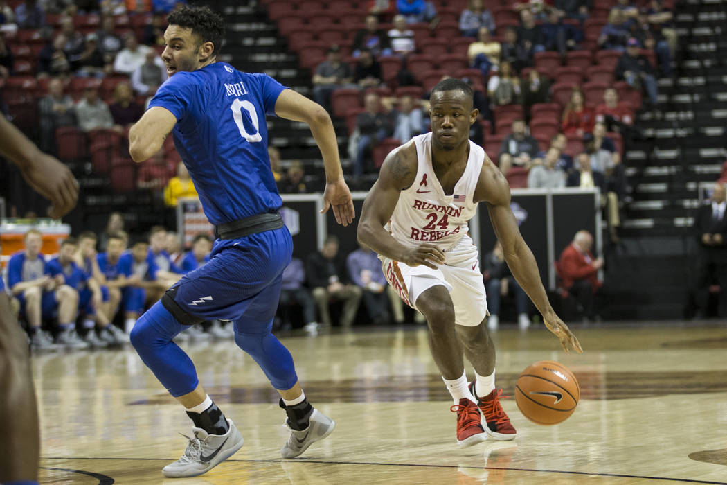 UNLV Rebels guard Jordan Johnson (24) runs the ball behind Air Force Falcons guard Caleb Morris (0) in the second half of the Mountain West Conference men's basketball tournament game at the Thoma ...