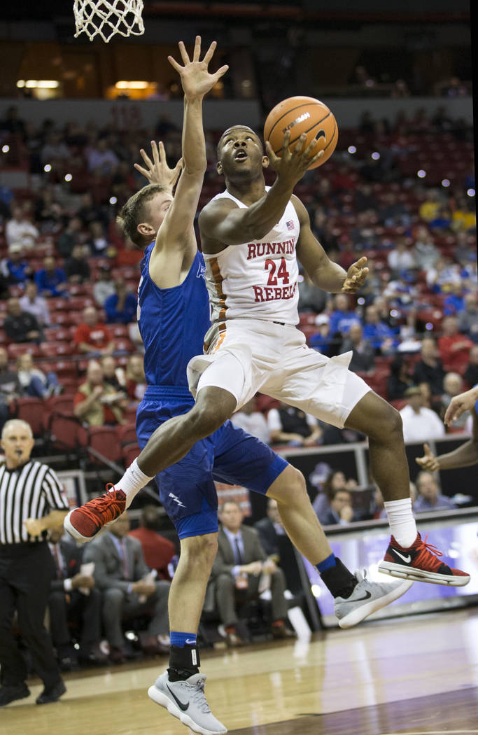 UNLV Rebels guard Jordan Johnson (24) shoots the ball for a score under pressure from Air Force Falcons guard Jacob Van (15) in the second half of the Mountain West Conference men's basketball tou ...