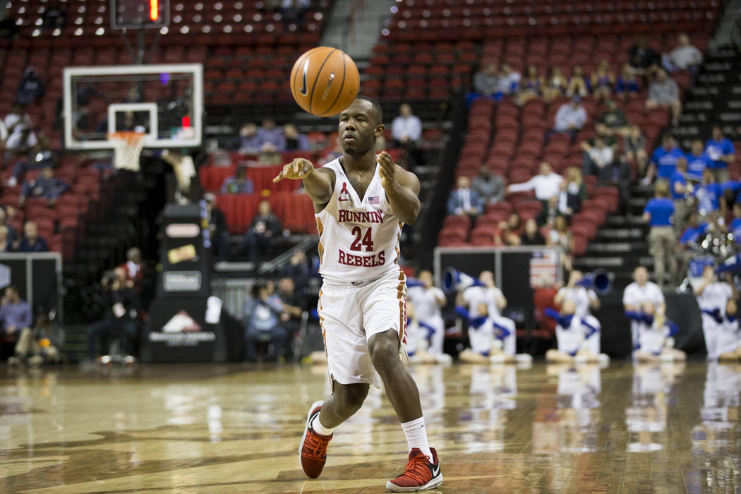 UNLV Rebels guard Jordan Johnson (24) makes a pass against Air Force Falcons in the second half of the Mountain West Conference men's basketball tournament game at the Thomas & Mack Center in  ...