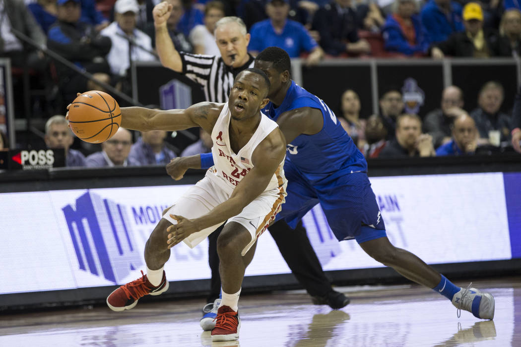 UNLV Rebels guard Jordan Johnson (24) if fouled by Air Force Falcons guard Trevor Lyons (20) in the second half of the Mountain West Conference men's basketball tournament game at the Thomas & ...