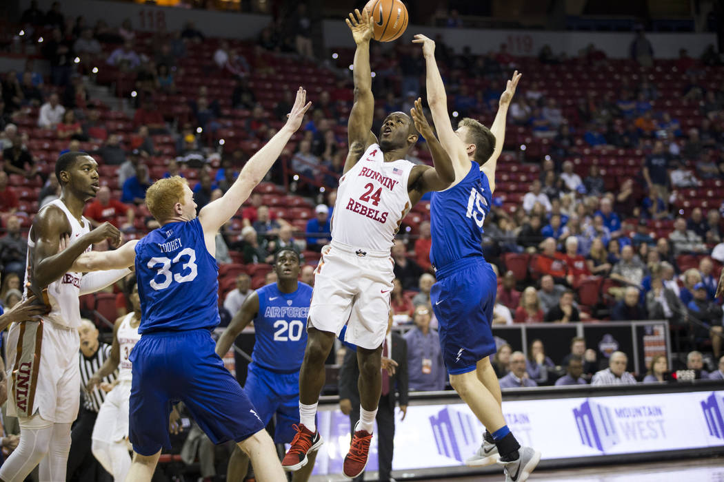 UNLV Rebels guard Jordan Johnson (24) gets his shot blocked by Air Force Falcons guard Jacob Van (15) during overtime in the Mountain West Conference men's basketball tournament game at the Thomas ...