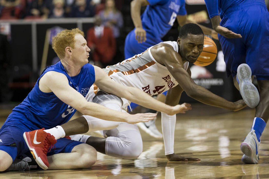 UNLV Rebels forward Brandon McCoy (44) loses the ball against Air Force Falcons center Frank Toohey (33) during overtime in the Mountain West Conference men's basketball tournament game at the Tho ...