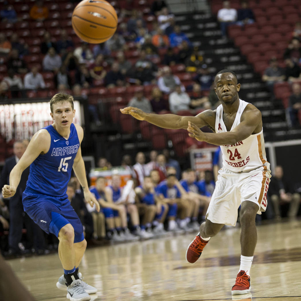 UNLV Rebels guard Jordan Johnson (24) makes a pass as Air Force Falcons guard Jacob Van (15) looks on in the second half of the Mountain West Conference men's basketball tournament game at the Tho ...