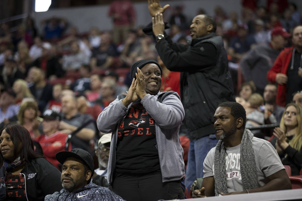 Fans react during the second half of the Mountain West Conference men's basketball tournament game between UNLV Rebels and Air Force Falcons at the Thomas & Mack Center in Las Vegas, Wednesday ...