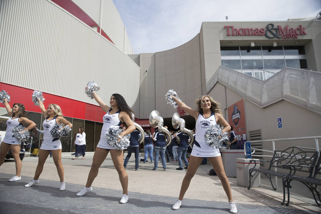 The Nevada Wolf Pack cheerleader squad outside of the Thomas & Mack Center before the Mountain West Conference men's basketball tournament game between Nevada Wolf Pack and UNLV Rebels, in Las ...