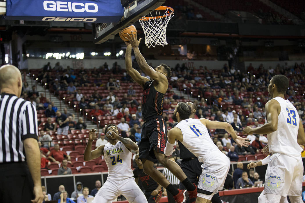 UNLV Rebels forward Shakur Juiston (10) goes up for a shot against Nevada Wolf Pack in the first half of the Mountain West Conference men's basketball tournament game at the Thomas & Mack Cent ...