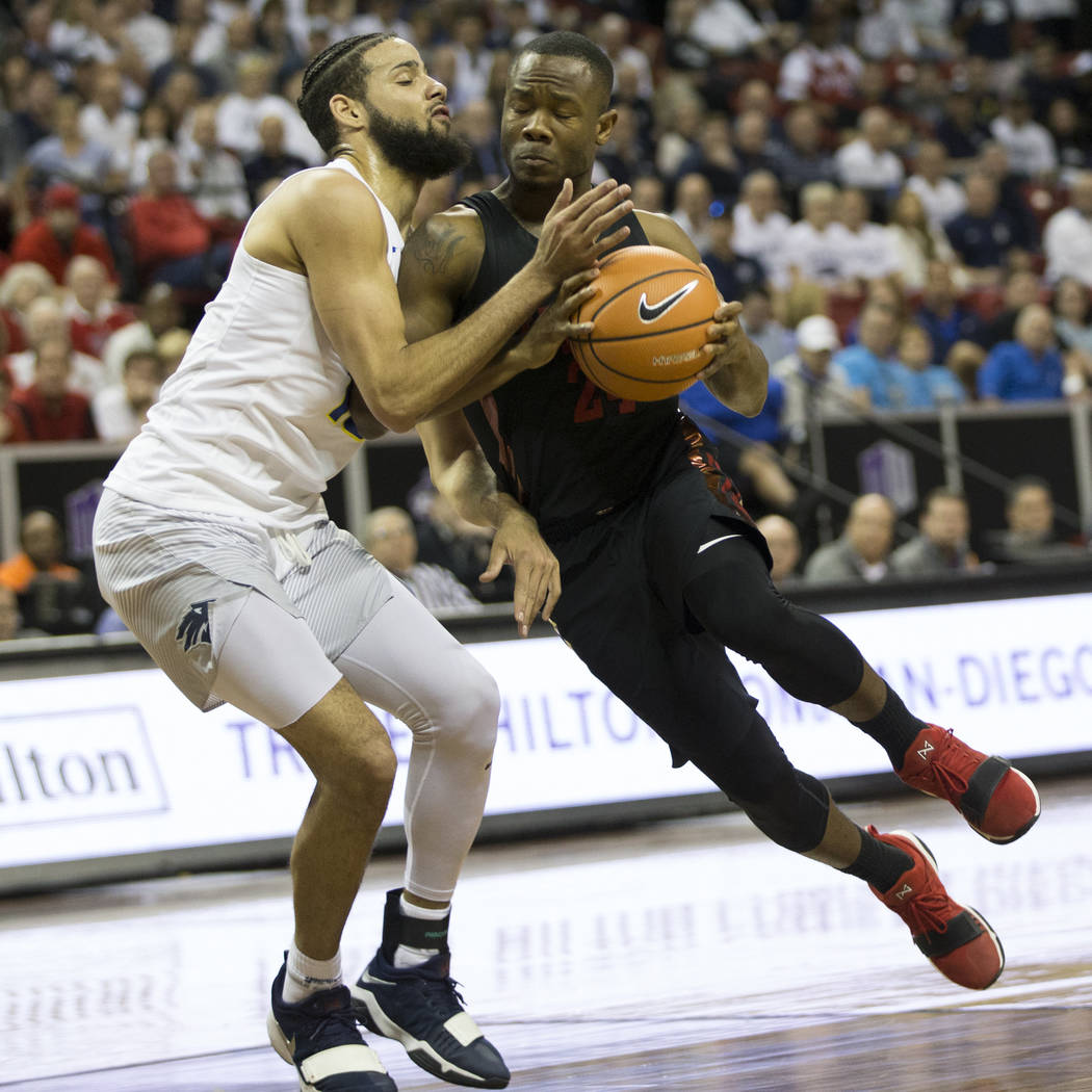 UNLV Rebels guard Jordan Johnson (24) is pressured by Nevada Wolf Pack forward Caleb Martin (10) in the second half of the Mountain West Conference men's basketball tournament game at the Thomas & ...