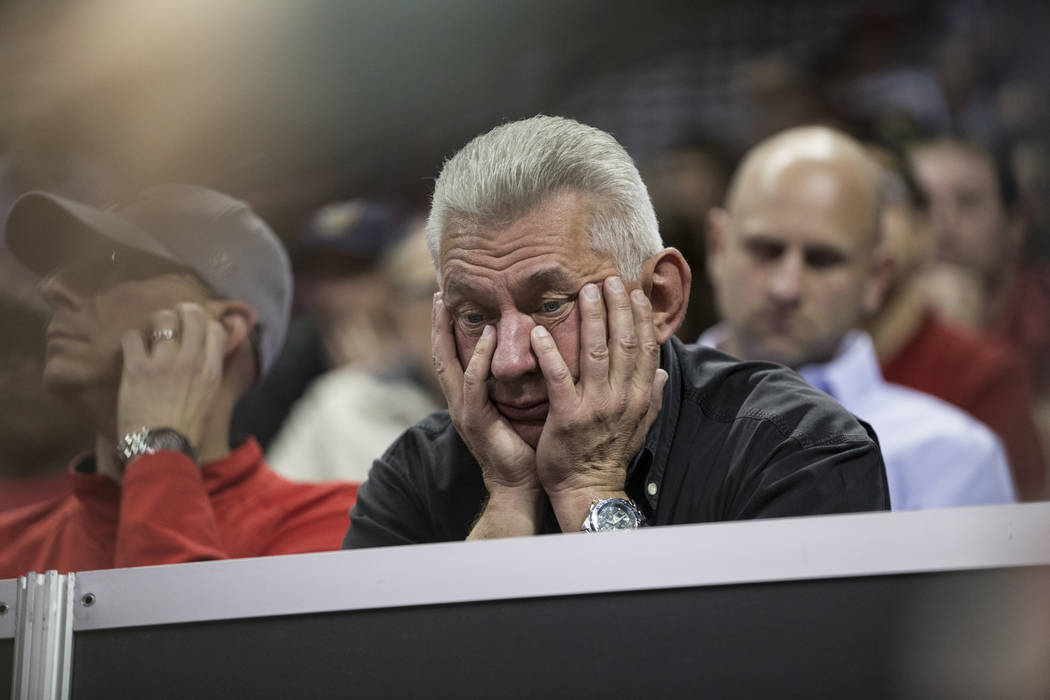 An UNLV fans watches the second half of the Mountain West Conference men's basketball tournament game against Nevada Wolf Pack at the Thomas & Mack Center in Las Vegas, Thursday, March 8, 2018 ...