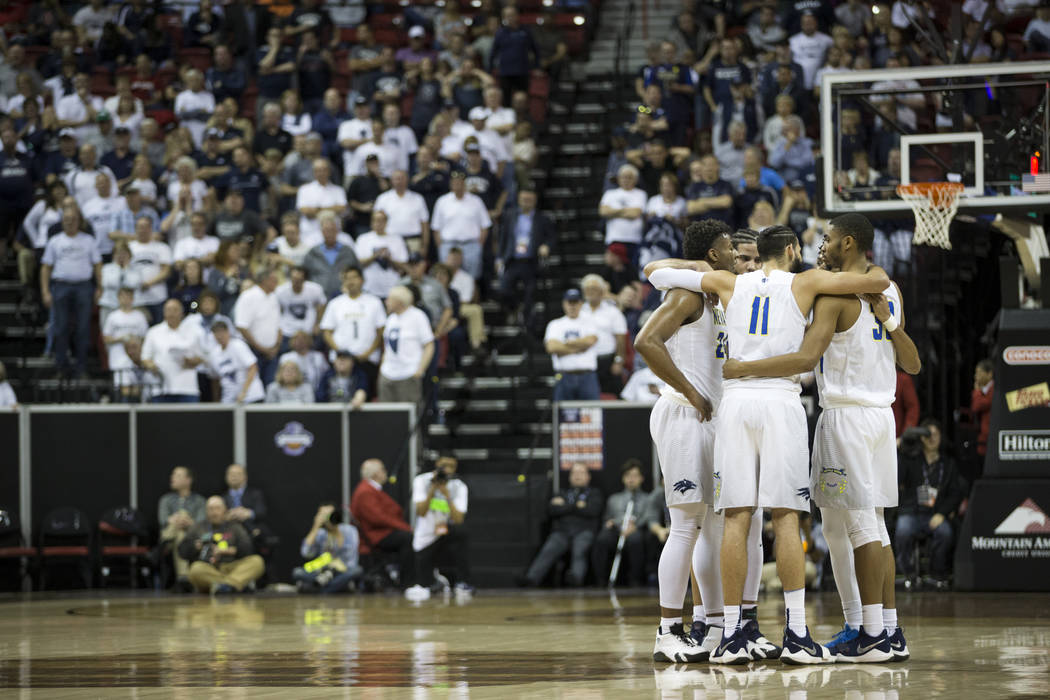 Nevada Wolf Pack players huddle on the court in the second half of the Mountain West Conference men's basketball tournament game against UNLV Rebels at the Thomas & Mack Center in Las Vegas, T ...