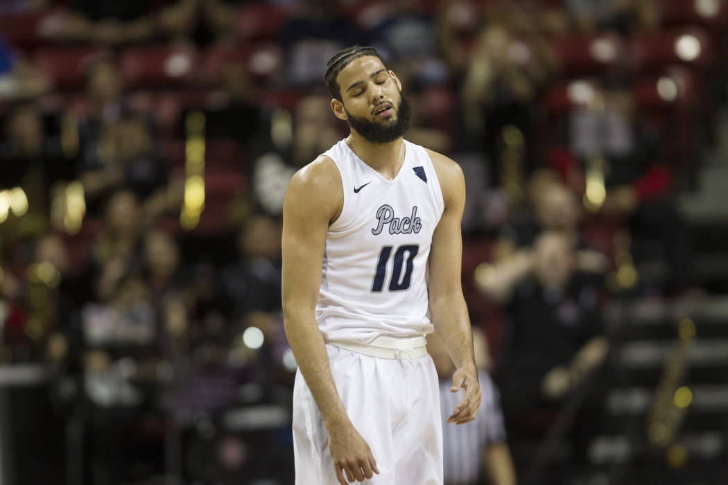 Nevada Wolf Pack forward Caleb Martin (10) reacts after shooting an air ball against San Diego State Aztecs in the first half of the Mountain West Conference men's basketball tournament semifinal  ...