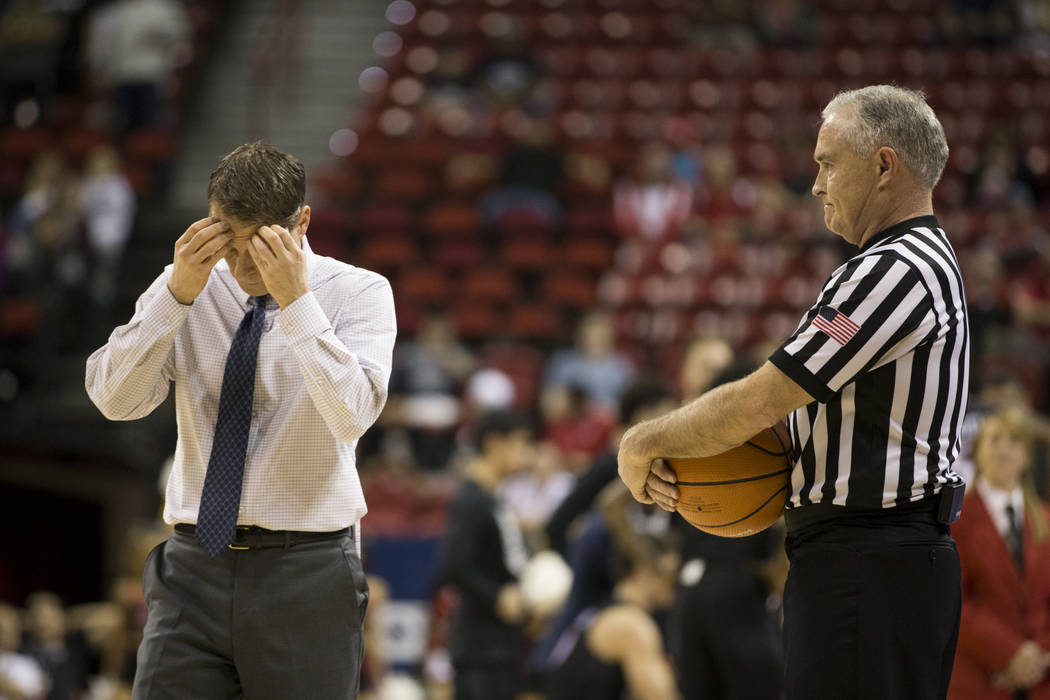 Nevada Wolf Pack head coach Eric Musselman reacts after a play against San Diego State Aztecs in the first half of the Mountain West Conference men's basketball tournament semifinal game at the Th ...