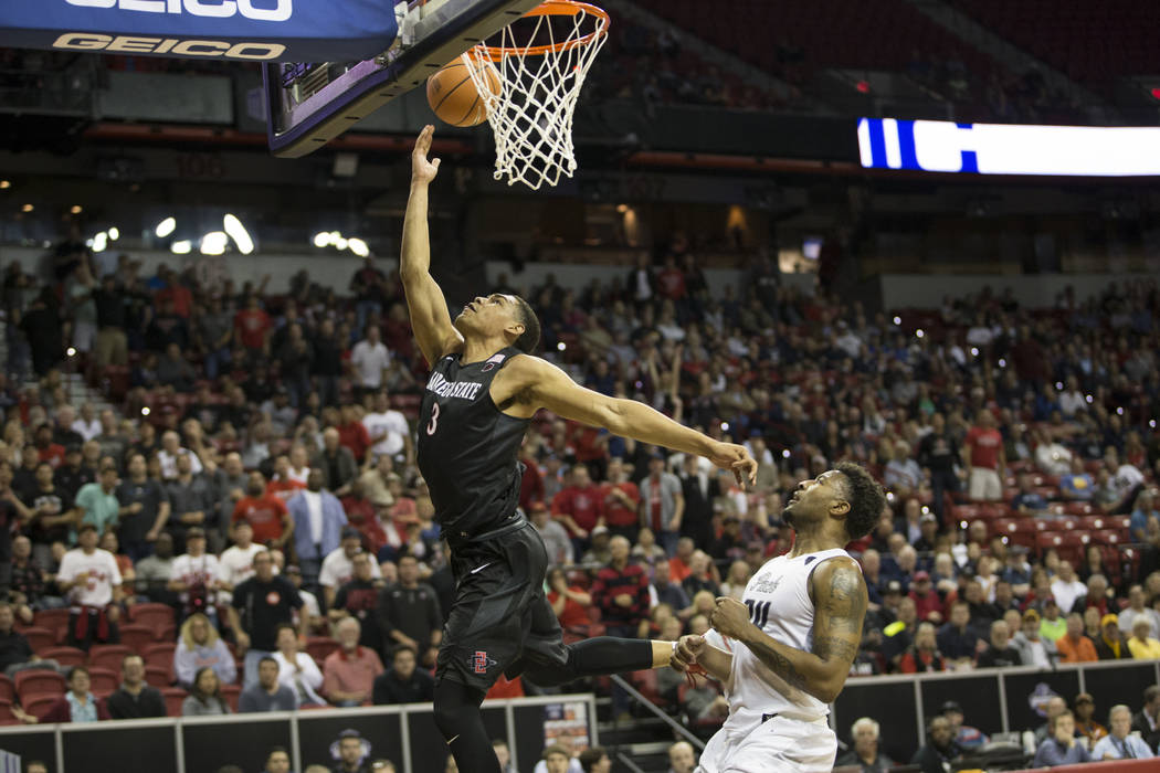 San Diego State Aztecs guard Trey Kell (3) goes up for a shot against Nevada Wolf Pack guard Jordan Caroline (24) in the first half of the Mountain West Conference men's basketball tournament semi ...
