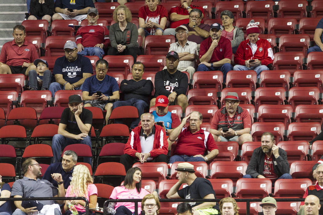 Fans watch the San Diego State Aztecs and Nevada Wolf Pack in the second half of the Mountain West Conference men's basketball tournament semifinal game at the Thomas & Mack Center in Las Vega ...