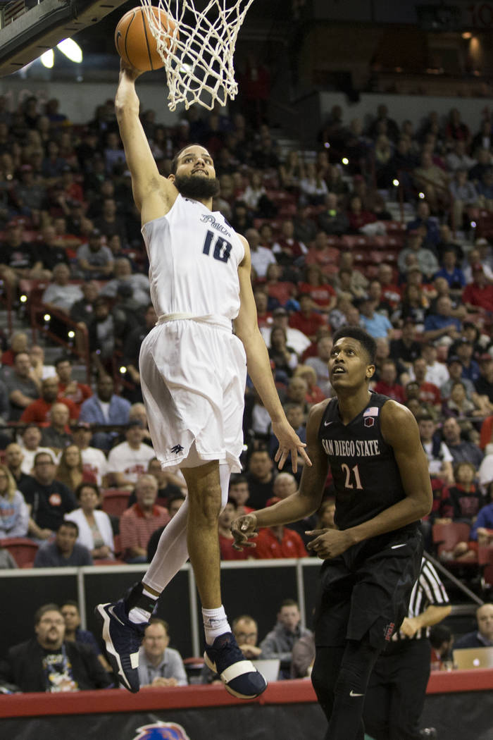 Nevada Wolf Pack forward Caleb Martin (10) leaps for a dunk against San Diego State Aztecs in the second half of the Mountain West Conference men's basketball tournament semifinal game at the Thom ...
