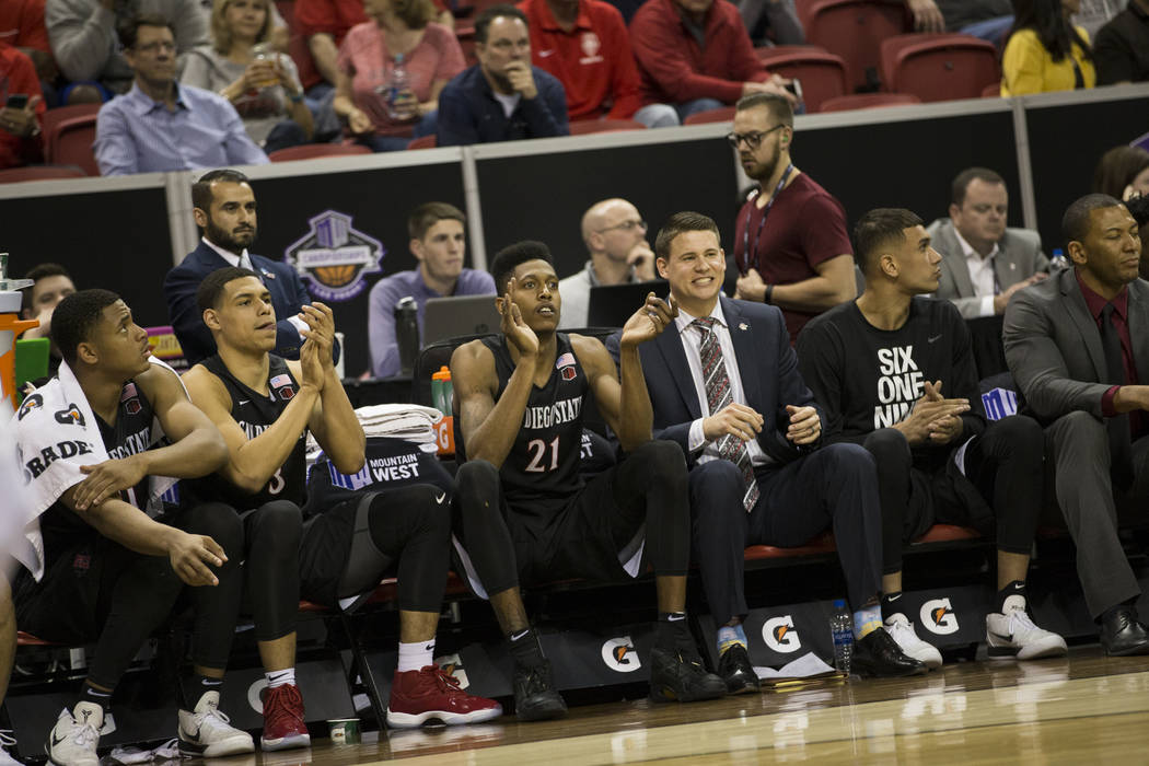 The San Diego State Aztecs bench reacts to a play against Nevada Wolf Pack in the second half of the Mountain West Conference men's basketball tournament semifinal game at the Thomas & Mack Ce ...