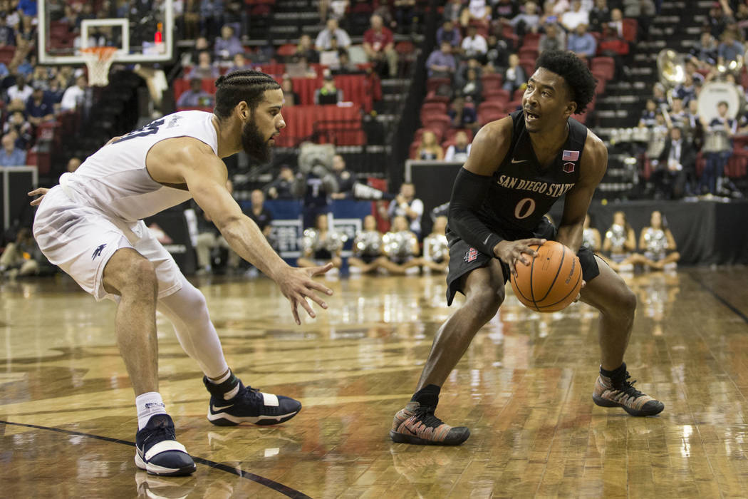 Nevada Wolf Pack forward Caleb Martin (10) guards San Diego State Aztecs guard Devin Watson (0) in the second half of the Mountain West Conference men's basketball tournament semifinal game at the ...