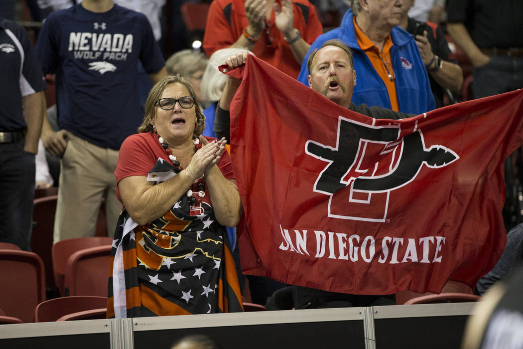 San Diego State Aztecs fans cheer their team after their win against Nevada Wolf Pack in the Mountain West Conference men's basketball tournament semifinal game at the Thomas & Mack Center in  ...