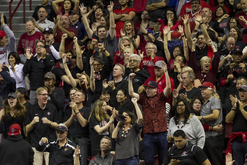 Fans watch a game between San Diego State Aztecs and New Mexico Lobos in the Mountain West Conference men's basketball tournament final at the Thomas & Mack Center in Las Vegas, Saturday, Marc ...