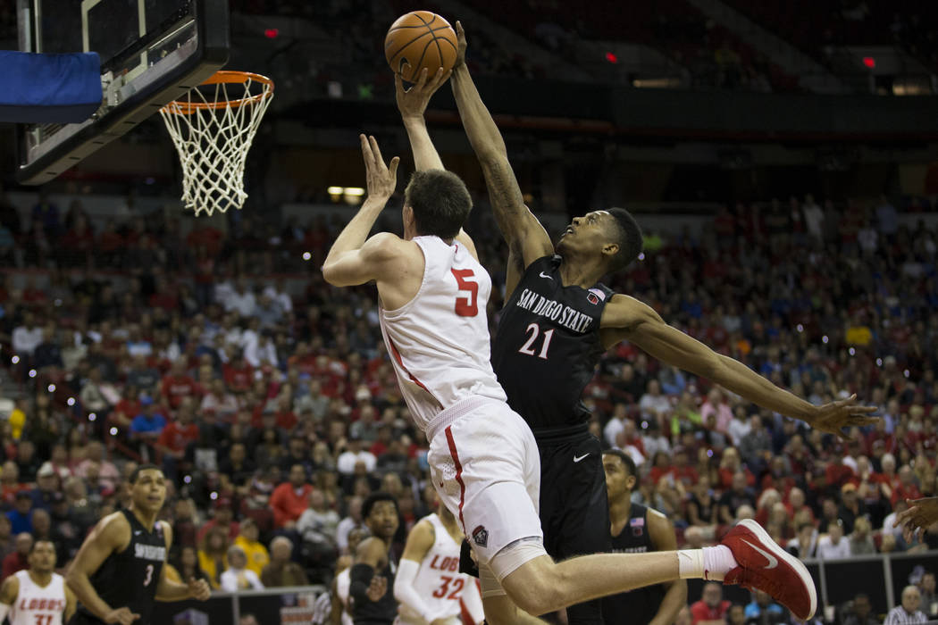 San Diego State Aztecs forward Malik Pope (21) makes a block against New Mexico Lobos forward Joe Furstinger (5) in the second half of the Mountain West Conference men's basketball tournament fina ...