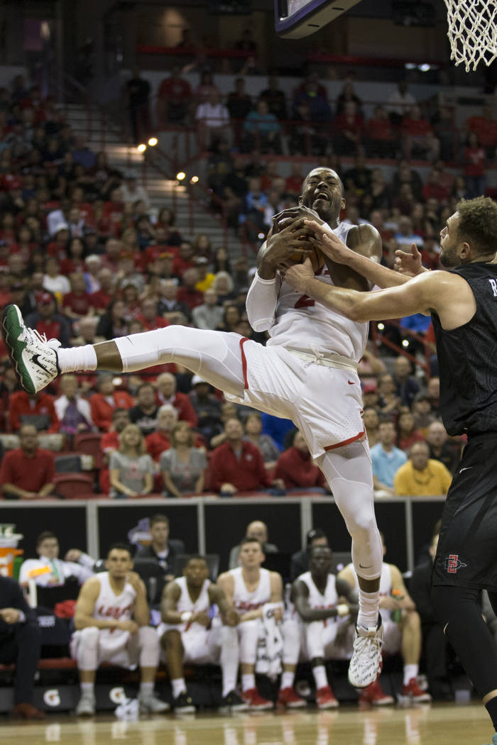 New Mexico Lobos guard Sam Logwood (2) is pressured against San Diego State Aztecs center Kameron Rooks (45) in the second half of the Mountain West Conference men's basketball tournament final at ...
