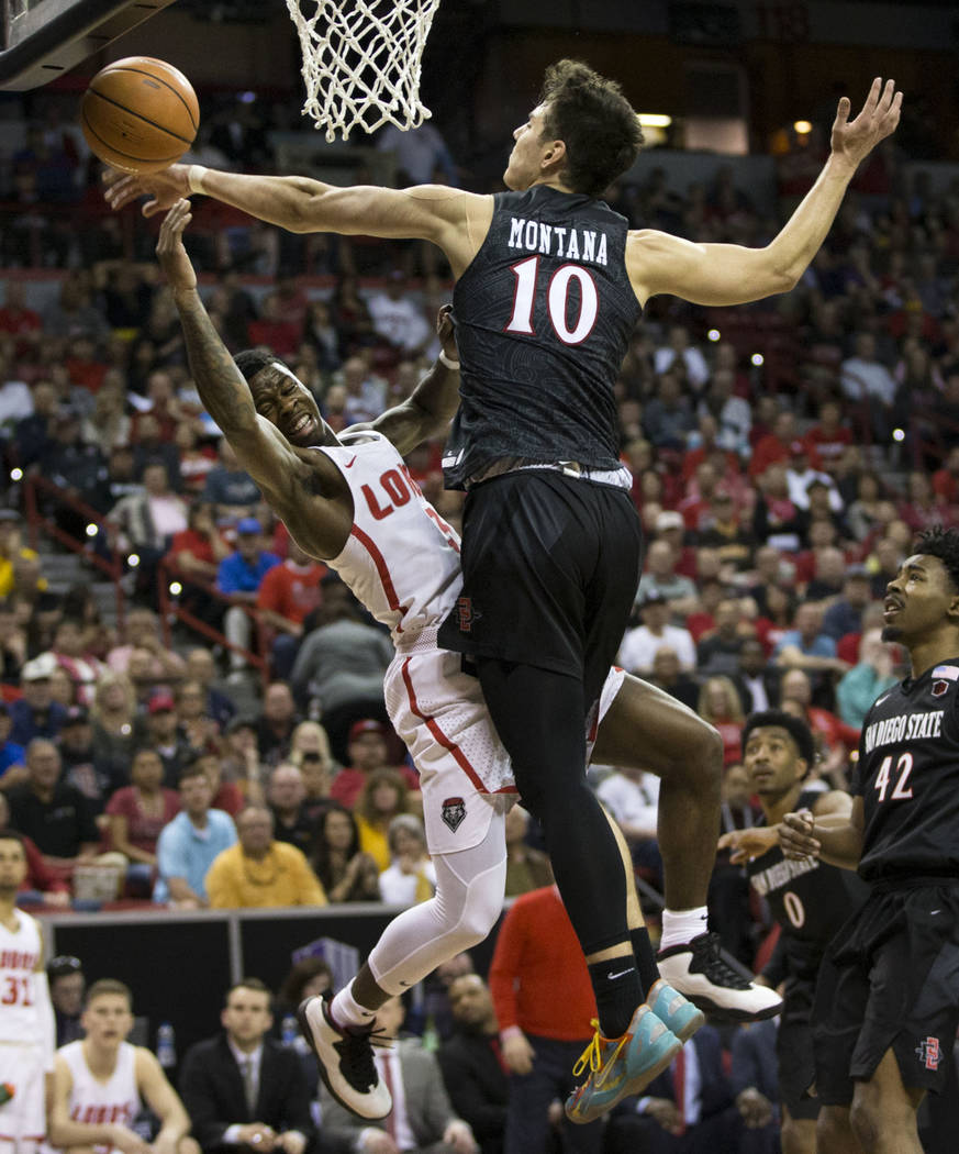 New Mexico Lobos guard Antino Jackson (3) is fouled against San Diego State Aztecs forward Max Montana (10) in the second half of the Mountain West Conference men's basketball tournament final at  ...