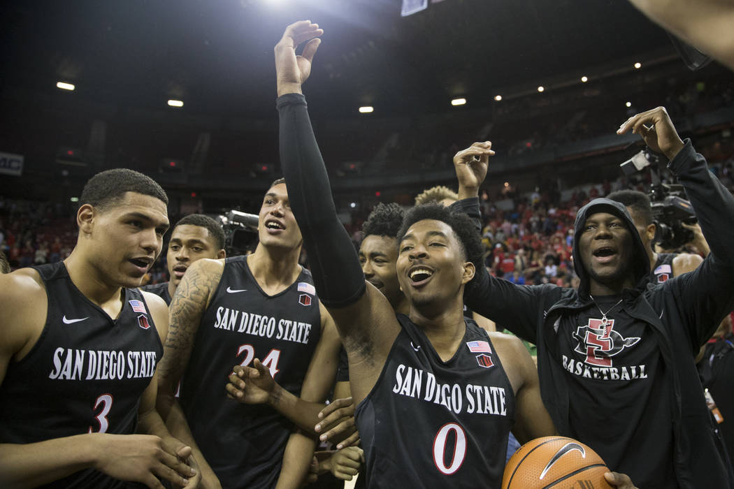 San Diego State Aztecs guard Trey Kell (3), forward Nolan Narain (24) and guard Devin Watson (0), celebrate their win in the Mountain West Conference men's basketball tournament final at the Thoma ...