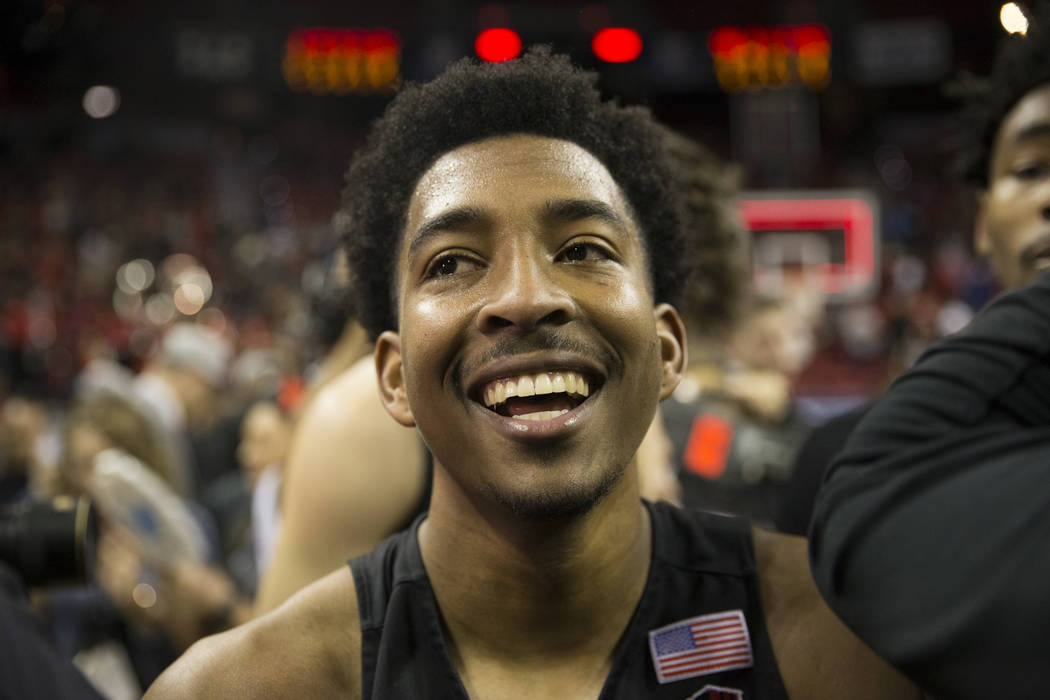 San Diego State Aztecs guard Devin Watson (0) celebrates after winning against New Mexico in the Mountain West Conference men's basketball tournament final at the Thomas & Mack Center in Las V ...