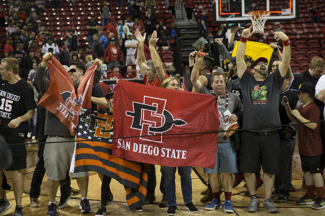 San Diego State Aztecs fans celebrate their team's win against New Mexico Lobos in the Mountain West Conference men's basketball tournament final at the Thomas & Mack Center in Las Vegas, Satu ...