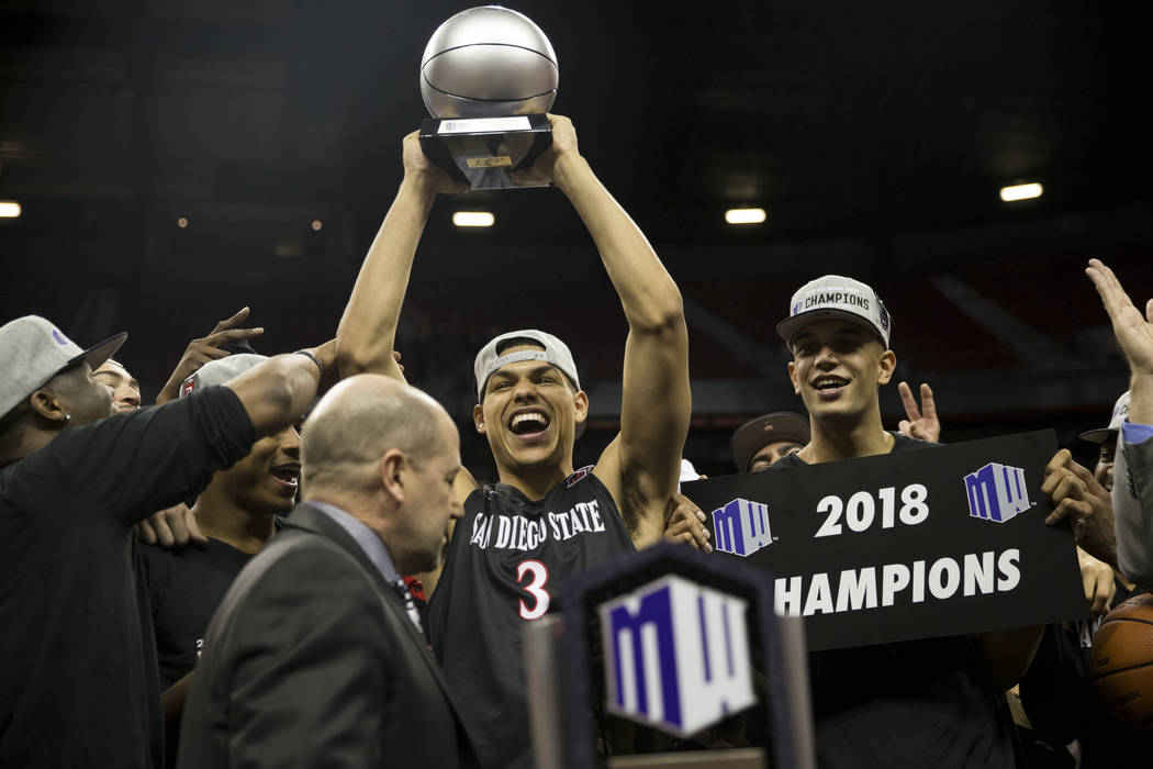 San Diego State Aztecs guard Trey Kell (3) raises his most valuable player trophy following a win against New Mexico Lobos in the Mountain West Conference men's basketball tournament final at the  ...