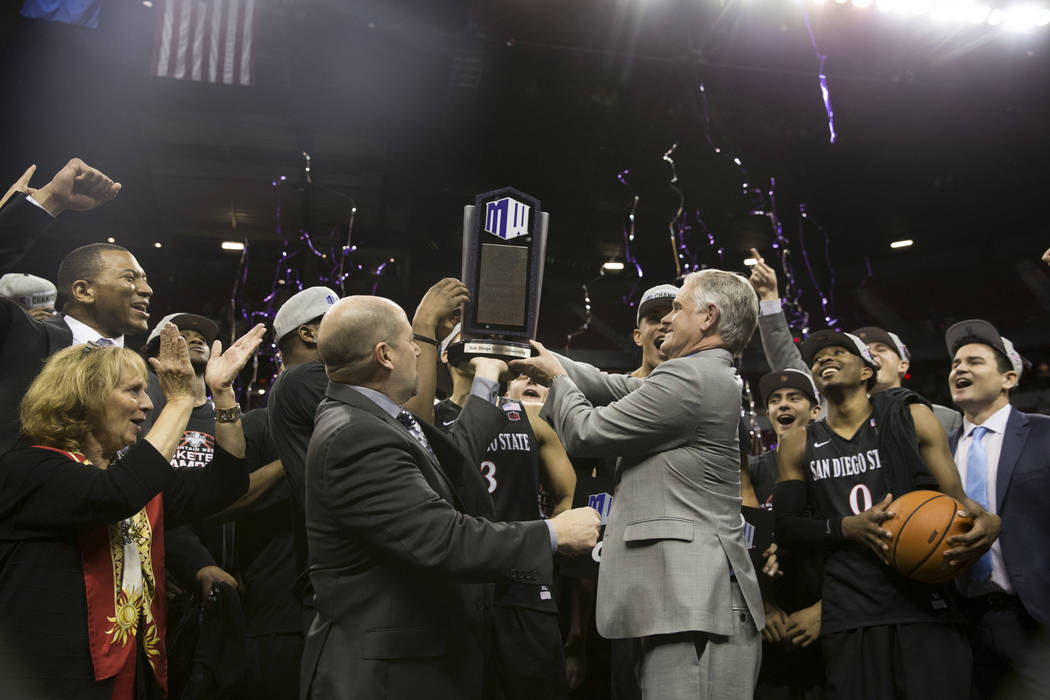 San Diego State Aztecs celebrate their win in the Mountain West Conference men's basketball tournament final at the Thomas & Mack Center in Las Vegas, Saturday, March 10, 2018. Erik Verduzco L ...