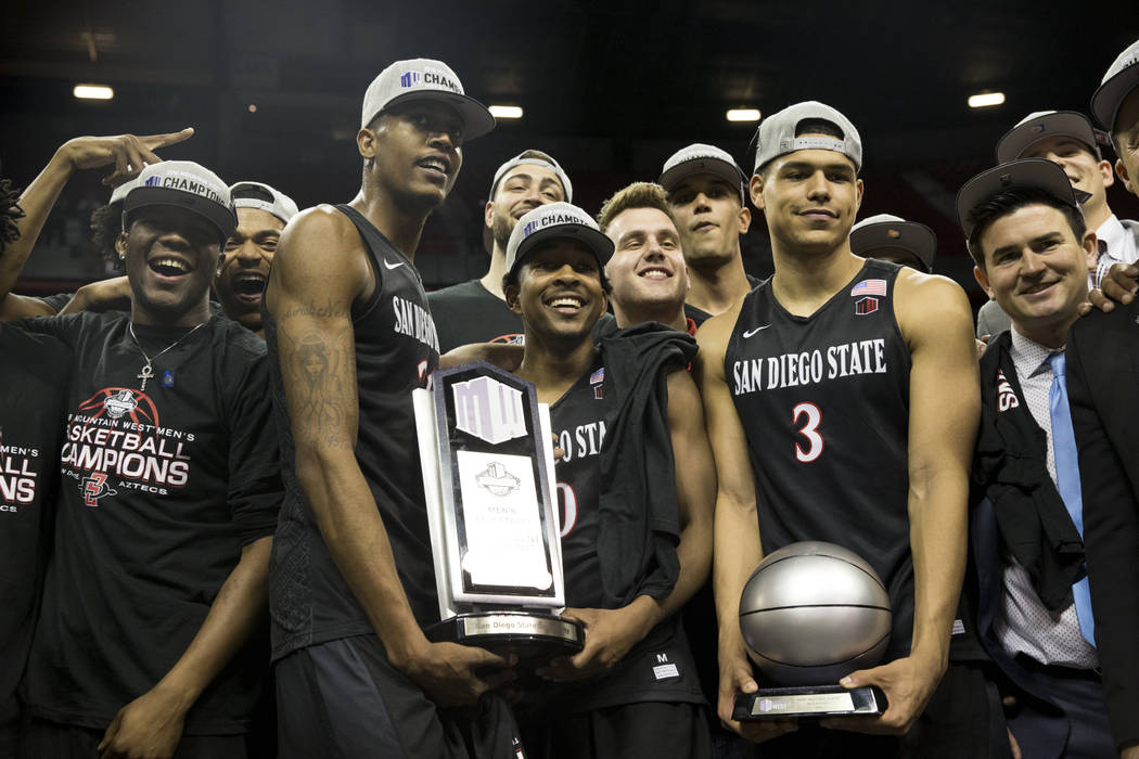 San Diego State Aztecs celebrate their win against New Mexico Lobos in the Mountain West Conference men's basketball tournament final at the Thomas & Mack Center in Las Vegas, Saturday, March  ...