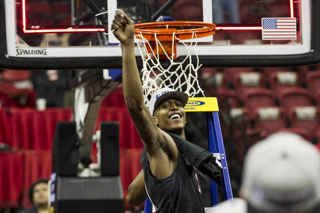 San Diego State Aztecs forward Malik Pope (21) after cutting a piece of the net following a win against New Mexico Lobos in the Mountain West Conference men's basketball tournament final at the Th ...