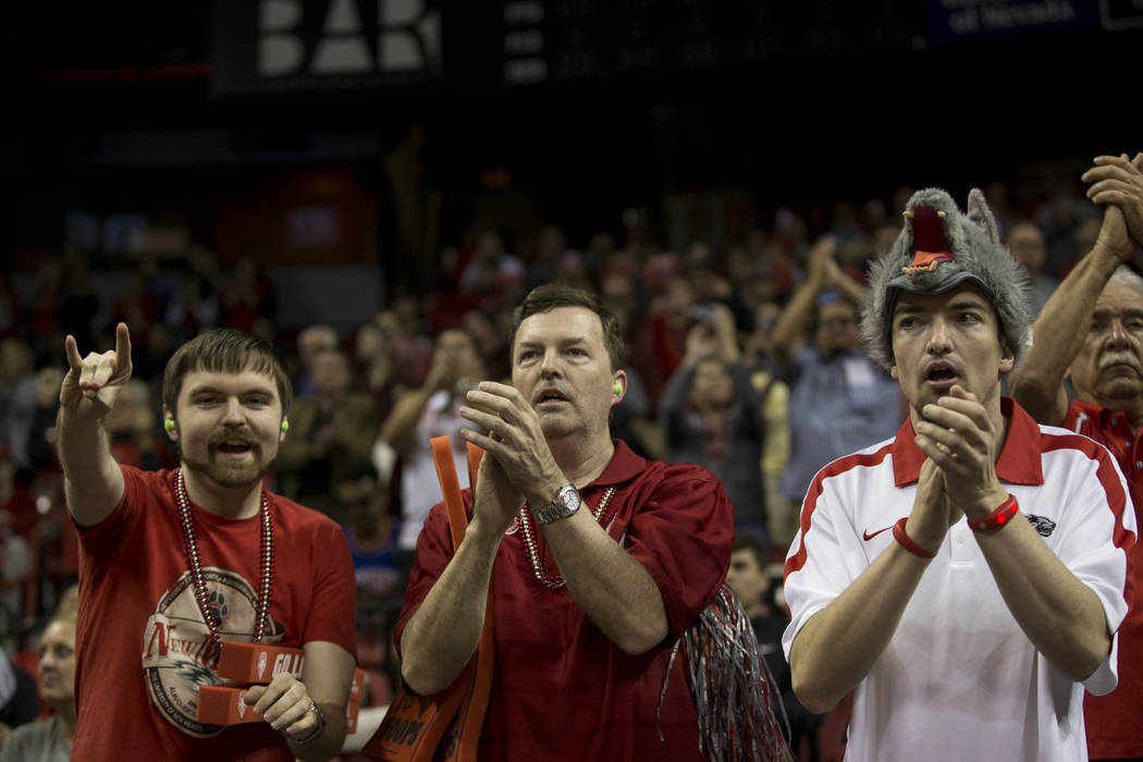 Fans watch the San Diego State Aztecs and New Mexico Lobos in the Mountain West Conference men's basketball tournament final at the Thomas & Mack Center in Las Vegas, Saturday, March 10, 2018. ...