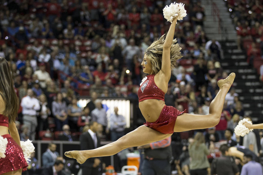A cheerleader performs in the first half of the Mountain West Conference men's basketball tournament final at the Thomas & Mack Center in Las Vegas, Saturday, March 10, 2018. Erik Verduzco Las ...