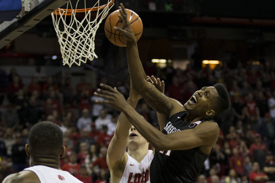 San Diego State Aztecs forward Malik Pope (21) goes up for a shot against New Mexico Lobos forward Vladimir Pinchuk (15) in the first half of the Mountain West Conference men's basketball tourname ...
