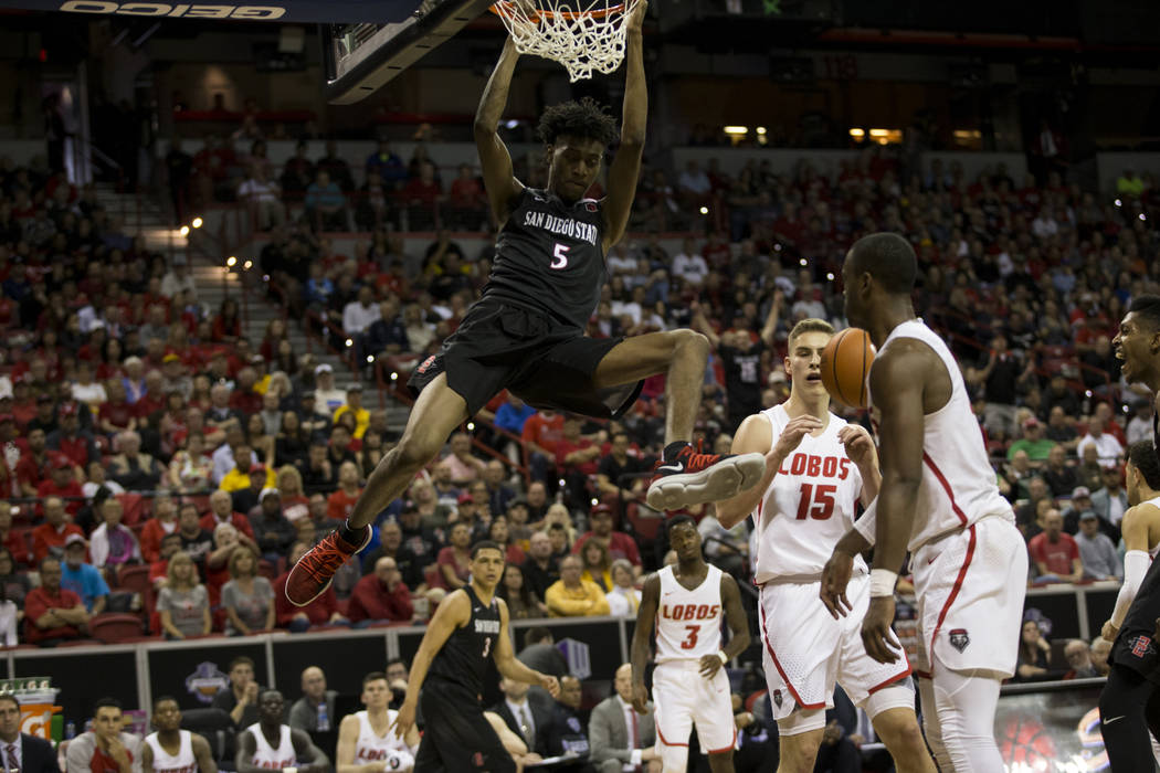 San Diego State Aztecs forward Jalen McDaniels (5) dunks the ball against New Mexico Lobos in the Mountain West Conference men's basketball tournament final at the Thomas & Mack Center in Las  ...