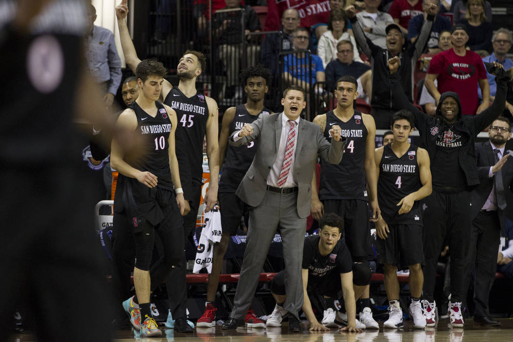 San Diego State Aztecs bench reacts to a play in the second half of the Mountain West Conference men's basketball tournament final at the Thomas & Mack Center in Las Vegas, Saturday, March 10, ...