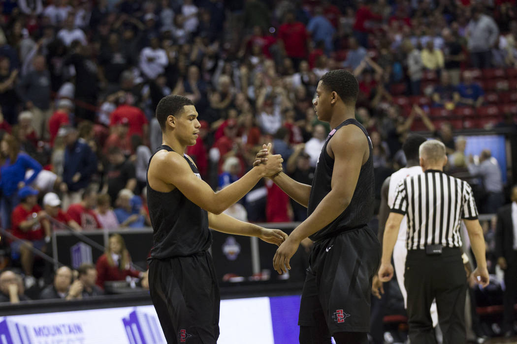 San Diego State Aztecs guard Trey Kell (3), left, and forward Matt Mitchell (11) as the clock runs out to win against New Mexico Lobos in the Mountain West Conference men's basketball tournament f ...