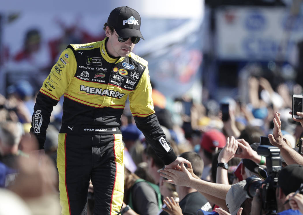 Ryan Blaney greets fans as he is introduced before the NASCAR Daytona 500 Cup series auto race at Daytona International Speedway in Daytona Beach, Fla., Sunday, Feb. 18, 2018. (AP Photo/John Raoux)
