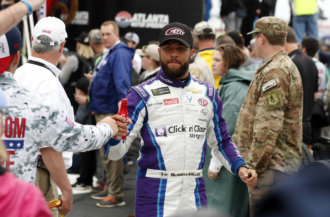 NASCAR Cup Series driver Darrell Wallace Jr. (43) greets fans after being introduced for the NASCAR Cup Series auto race at Atlanta Motor Speedway in Hampton, Ga., on Sunday, Feb. 25, 2018. (AP Ph ...