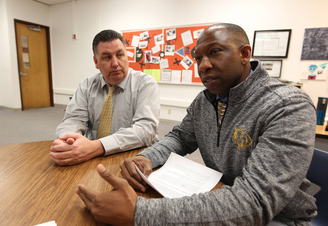 Principal Joe Petrie, left, and Behavioral Strategist Jermone Riley of Bonanza High School in Las Vegas talk to a reporter at the school Wednesday, Feb. 21, 2018. Riley's position, to proactively  ...